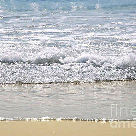 Ocean shore with sparkling waves by Elena Elisseeva