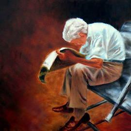 Old man reading by Uma Krishnamoorthy