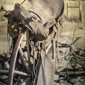 Janice Rae Pariza - Old Saddle on Wagon Wheel