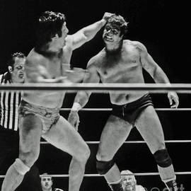Jim Fitzpatrick - Old School Wrestlers Dean Ho and Don Muraco Battling it out in the Middle of the Ring