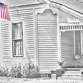Old Style House with US Flag by Linda Phelps