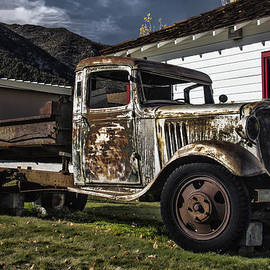 Old Truck Along The Way by Erika Fawcett