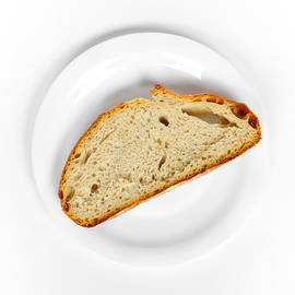 One slice of bread white plate and background