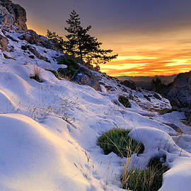 Orange sunset at the mountains by Guido Montanes Castillo
