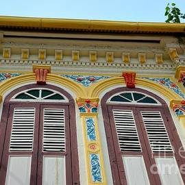 Ornate decorated shophouse windows shutters and wall in Malacca Malaysia by Imran Ahmed