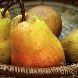 Pears in a basket by Elena Elisseeva