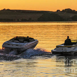 Fast Boats after Sunset by Kim Lessel