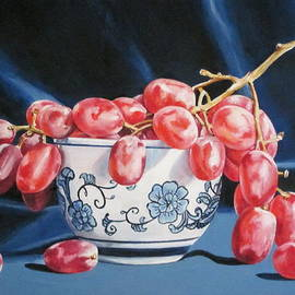 Red grapes in teacup by Lillian  Bell