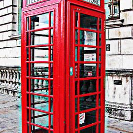 Red telephone box call box in London