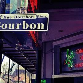 Rue Bourbon Street by Jeanne May