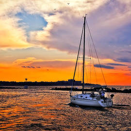 Sailing at Sunset Cleveland Harbor by Marcia Colelli
