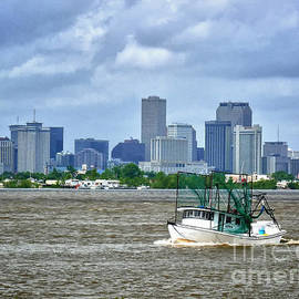 Shrimp Boat going by the City of New Orleans by Jeanne  Woods