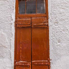 Brown shutters by Patricia Hofmeester