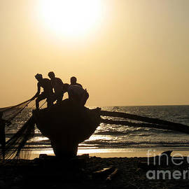 Silhouetted Fishermen in Goa by Pete Edmunds