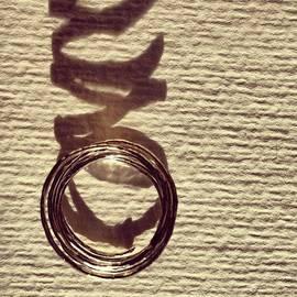 Silver circles and shadows