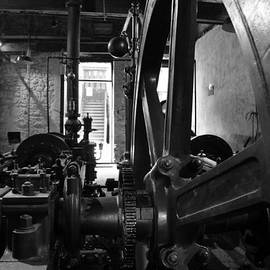 Steam engine flywheel at Lockes distillery BW  by RicardMN Photography