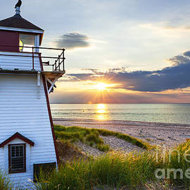 Sunset at Covehead Harbour Lighthouse by Elena Elisseeva