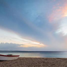 Sunset at the beach by Paul Quinn