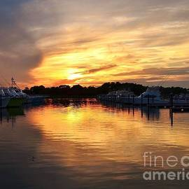 Sunset At The Indian River Marina Delaware by Kim Bemis
