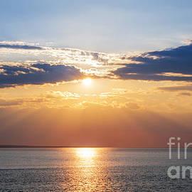 Sunset sky over ocean by Elena Elisseeva