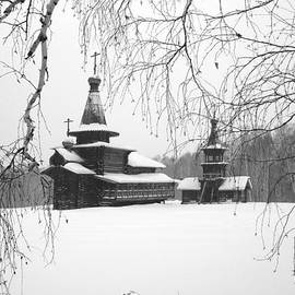 Roman Popov - The ancient wooden temple in snow is visible through branches of trees