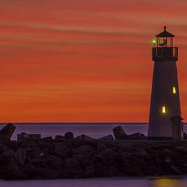 The Harbor Light at Sundown by Bruce Frye