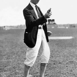 Track & Field Starter Man by Underwood Archives