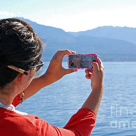 Traveler Taking Pictures From Ferry by Connie Fox