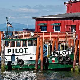 Tug Boat Pilot Docked on Waterfront Art Prints