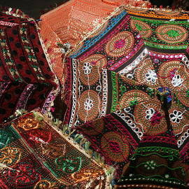 Umbrellas In The Textile Souk  by Kathy Peltomaa Lewis