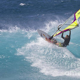Windsurfer on turquoise wave by Bryan Keil