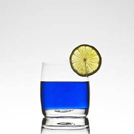 blue cocktail with lemon by Joana Kruse