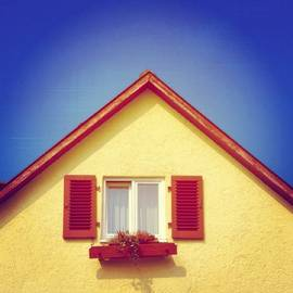 Gable of beautiful house in front of blue sky