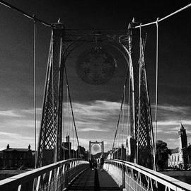 Joe Fox - pedestrian suspension footbridge the greig street bridge over the river ness inverness highland scot