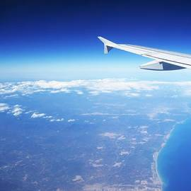 Aerial View IIi Airplane Flying Over Valencia In Spain Headed East Towards The Mediterranean Sea by John Shiron