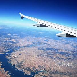 Aerial View With Airplane Wing On Take Off From Madrid Airport In Spain  by John Shiron