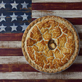 Apple pie on folk art  American flag by Garry Gay
