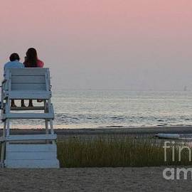 Family watching a sunset by Meandering Photography