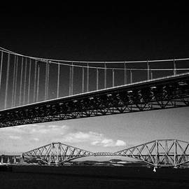 Joe Fox - firth of forth bridges forth road bridge in foreground rail bridge in background scotland uk