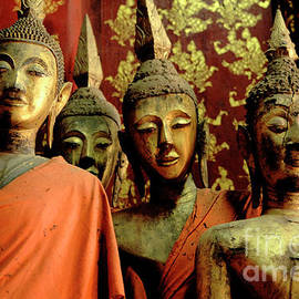 Four Buddhas Of Laos by Bob Christopher