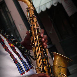 French Quarter Sax Player by Jeanne  Woods