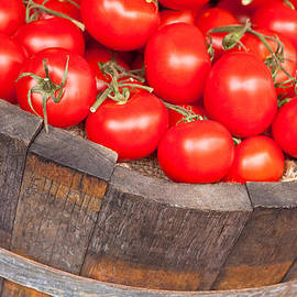 Tom Gowanlock - Fresh red tomatoes in a wooden bucket