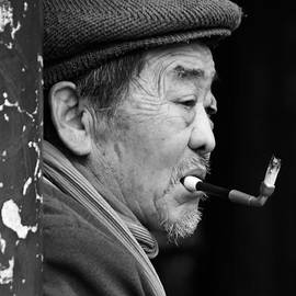 Old Man with a Cigarette by Marko Moudrak