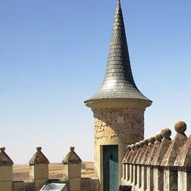 On The Roof Of Segovia Castle With Cone Shaped Railing In Spain by John Shiron