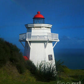 Pouto Lighthouse with Rainbow New Zealand by Mark Dodd