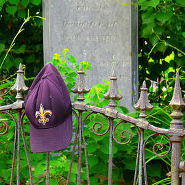 Saints Hat on Iron Fence by Jeanne  Woods