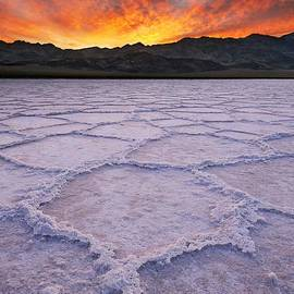 Fiery Sunrise Over Salt Patterns at Badwater  by Tom Schwabel