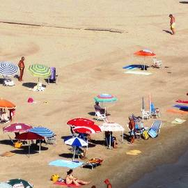 Sun Bathers And Beach Umbrellas In Peniscola Spain by John Shiron