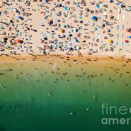 Radu Bercan - Aerial View From Flying Drone Of People Crowd Relaxing On Algarve Beach In Portugal