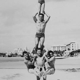 Archive Holdings Inc. - Men And Girl Perform Acrobatics On Beach